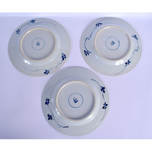 1613 - A SET OF THREE 17TH CENTURY CHINESE BLUE AND WHITE PORCELAIN PLATES Kangxi, painted with floral spra...