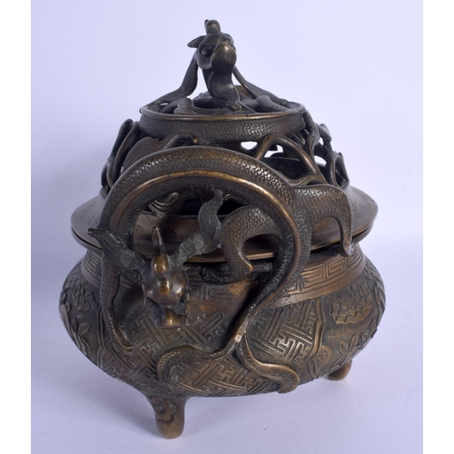 1653 - A LARGE 19TH CENTURY CHINESE TWIN HANDLED BRONZE CENSER AND COVER Qing, decorated with figures and l...