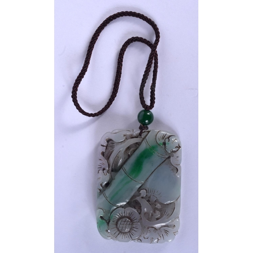 1690 - A CHINESE CARVED JADEITE PENDANT 20th Century. 5.5 cm x 4 cm....