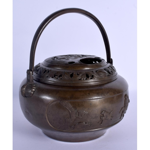 1710 - A LARGE 19TH CENTURY CHINESE BRONZE HAND WARMER AND COVER decorated with openwork figures and landsc...