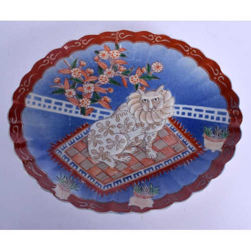 1712 - A RARE 19TH CENTURY JAPANESE MEIJI PERIOD IMARI SCALLOPED DISH painted with a central cat. 25 cm x 2...