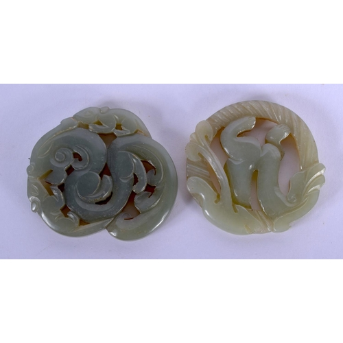 1726 - TWO EARLY 20TH CENTURY CHINESE CARVED JADE PLAQUES Late Qing. 5 cm diameter. (2)...