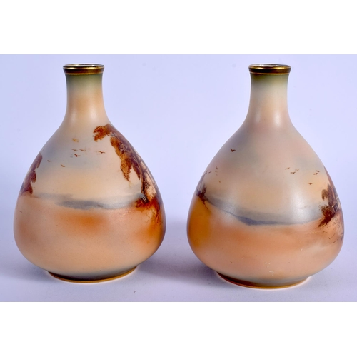 175 - Royal Worcester fine and rare pair of vases painted in tones of browns and greens with cottage scene...