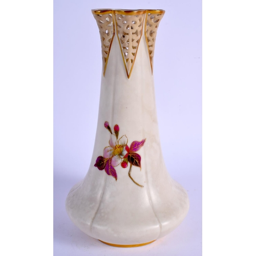 179 - Late 19th c. Grainger Worcester ivory vase with reticulated neck painted with flowers. 18.5cm high...
