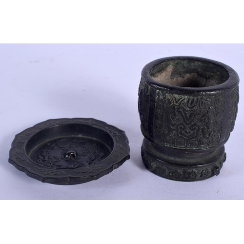 1798 - A CHINESE MING DYNASTY BRONZE CENSER together with a similar dish. Largest 6 cm x 4 cm. (2)...