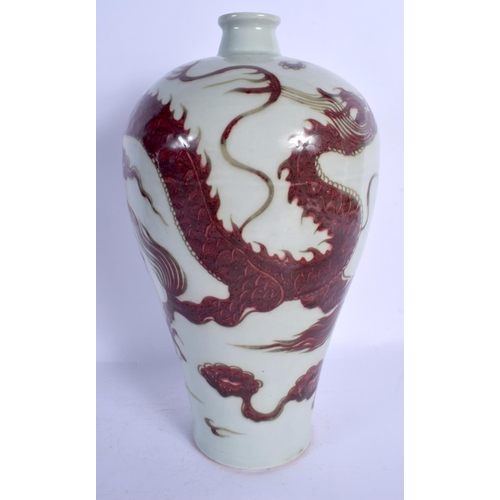 1801 - A LARGE CHINESE QING DYNASTY IRON RED PAINTED MEIPING VASE decorated with a dragon. 35 cm high....