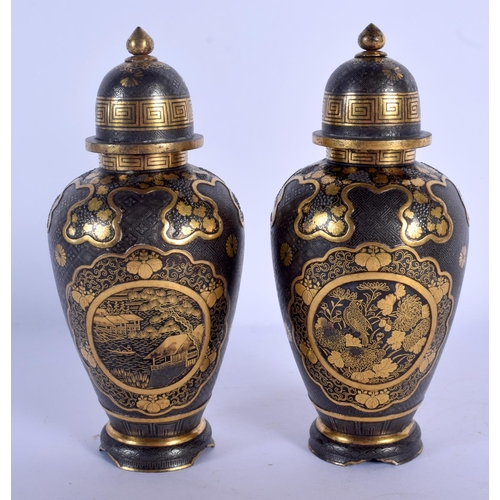 1803 - A MAJESTIC PAIR OF 19TH CENTURY JAPANESE MEIJI PERIOD IRON VASES AND COVER by the Moriguchi of Tokyo...