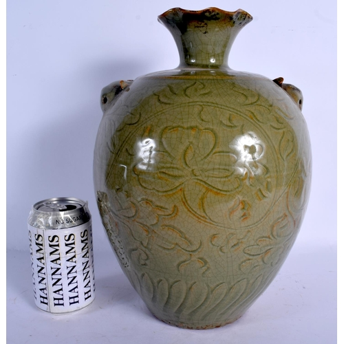 1836 - A LARGE 19TH CENTURY CHINESE CELADON BULBOUS VASE Qing, engraved with foliage and vines. 33 cm high....