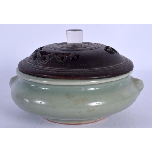 1838 - AN 18TH CENTURY CHINESE CELADON CENSER Qing, with carved wood and rock crystal cover. 11 cm wide....