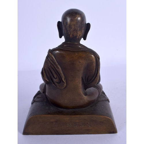 1846 - A CHINESE TIBETAN BRONZE FIGURE OF A SEATED BUDDHA 20th Century, modelled with hands clasped. 16 cm ...