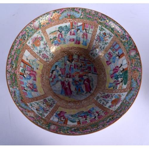 1851 - A LARGE 19TH CENTURY CHINESE CANTON FAMILLE ROSE PORCELAIN BOWL Qing, painted with figures within in...