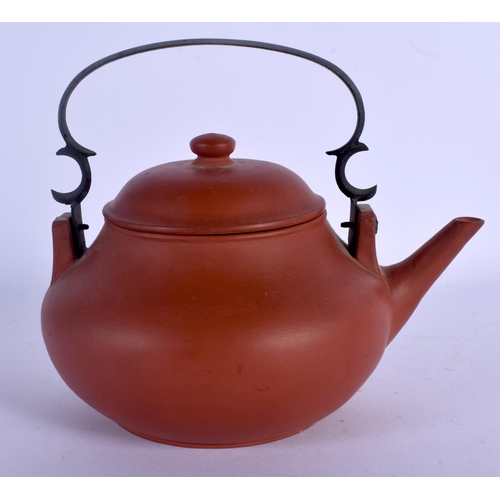 1853 - AN EARLY 20TH CENTURY CHINESE YIXING POTTERY TEAPOT AND COVER Late Qing, bearing Kangxi marks to bas...