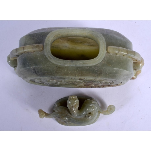 1873 - A CHINESE CARVED JADE VASE AND COVER 20th Century, decorated with a stylised dragon. 18 cm x 16 cm....