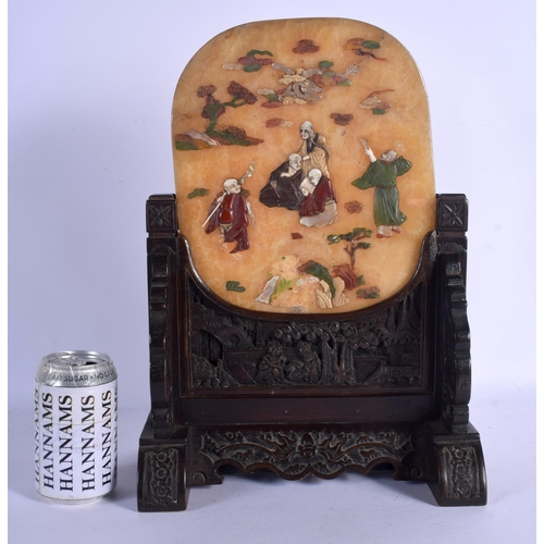 1890 - A LARGE 19TH CENTURY CHINESE CARVED HARDSTONE SCHOLARS SCREEN Qing, decorated with scholars within a...