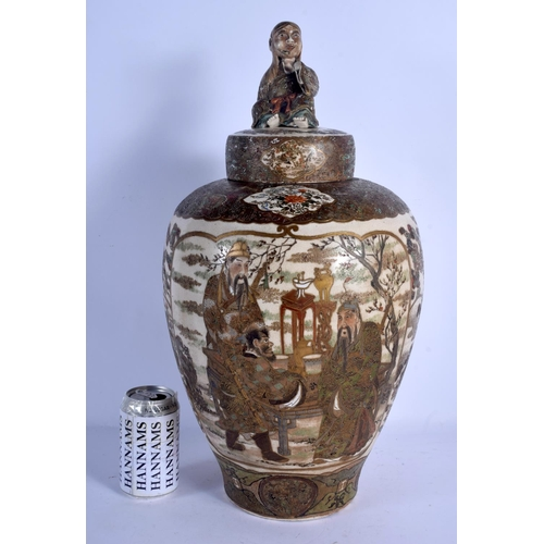 1895 - A LARGE 19TH CENTURY JAPANESE MEIJI PERIOD SATSUMA VASE AND COVER painted with scholars and landscap...