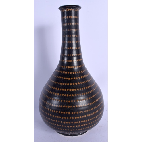 1897 - A CHINESE STONEWARE BULBOUS VASE 20th Century, painted with brown dimples .29 cm high....