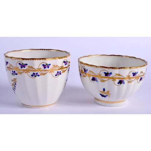 193 - 18th c. Derby rare beaker and stand painted with cornflowers with gilding and a similar teabowl and ...