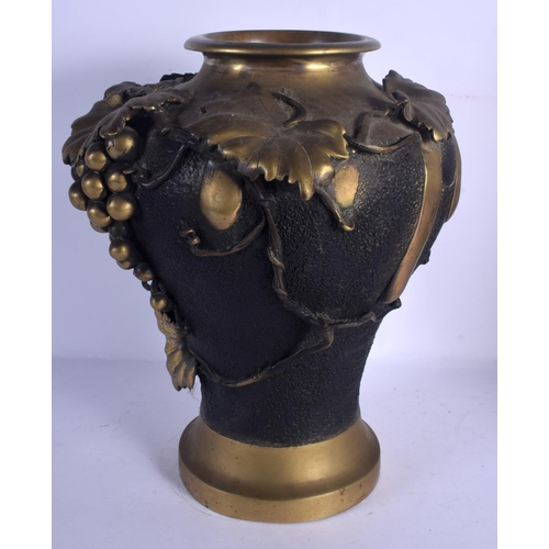 1943 - A LARGE 19TH CENTURY JAPANESE MEIJI PERIOD BRONZE VASE overlaid with berries and vines. 38 cm x 28 c...