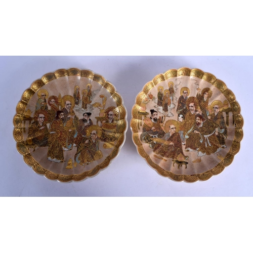 1962 - A PAIR OF 19TH CENTURY JAPANESE MEIJI PERIOD SCALLOPED SATSUMA PLATES painted with immortals. 18 cm ...
