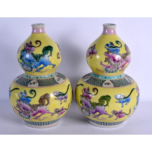 1977 - A LARGE PAIR OF CHINESE DOUBLE GOURD PORCELAIN VASES 20th Century, painted with buddhistic lions. 36...
