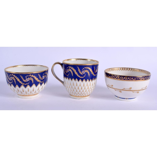 198 - 18th c. Derby coffee cup, teabowl and saucer with teardrop gilding and blue border with enamelled fl...
