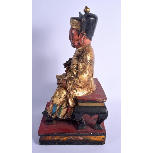 1988 - A LARGE 19TH CENTURY CHINESE GILTWOOD FIGURE OF AN IMMORTAL Qing. 44 cm x 30 cm....