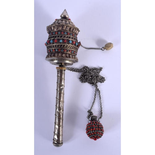 2009 - AN EARLY 20TH CENTURY CHINESE WHITE METAL CORAL AND TURQUOISE PRAYER WHEEL. 20 cm long....