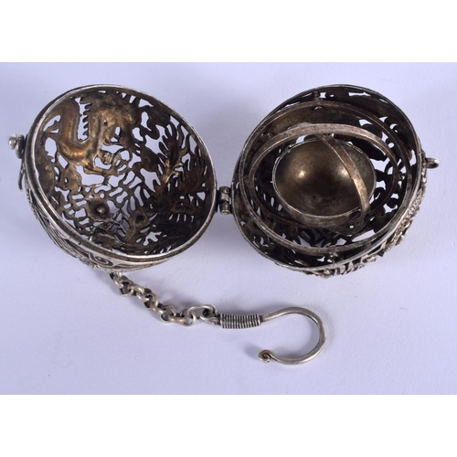 2038 - A CHINESE WHITE METAL TRAVELLING CENSER. 5 cm wide....