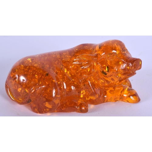 2047 - A CHINESE CARVED AMBER FIGURE OF A PIG 20th Century. 136 grams. 9 cm wide....