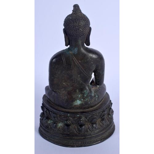 2068 - A 19TH CHINESE TIBETAN BRONZE BUDDHA modelled upon a triangular base. 16 cm x 9 cm....