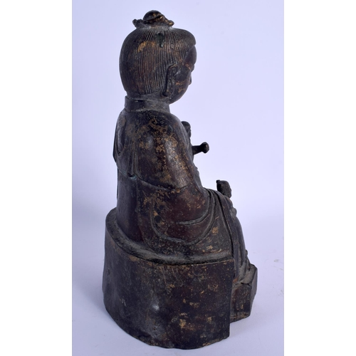 2080 - A CHINESE FIGURE OF A SEATED BUDDHA modelled with two attendants. 25 cm high....