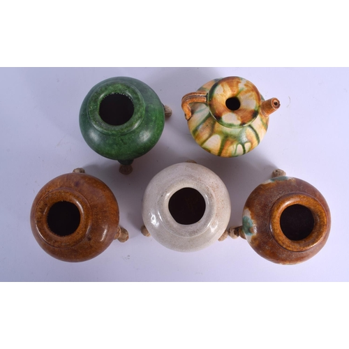2082 - FIVE CHINESE TANG STYLE POTTERY CENSERS in various forms. Largest 7.5 cm wide. (5)...