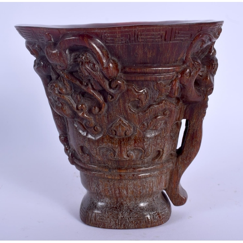 2096 - A CHINESE CARVED BUFFALO HORN LIBATION CUP 20th Century. 13 cm x 13 cm....