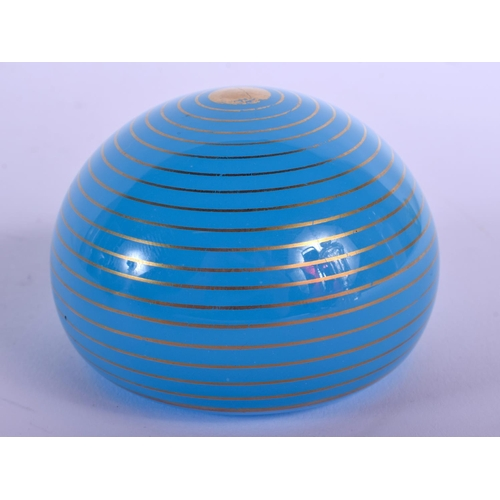 21 - AN UNUSUAL BACCARAT BLUE SWIRL GLASS PAPERWEIGHT. 5.5 cm wide....