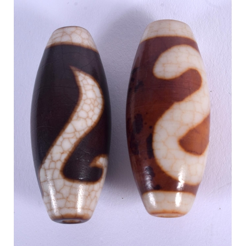 2101 - TWO CHINESE TIBETAN AGATE BEADS 20th Century. 5 cm long. (2)...