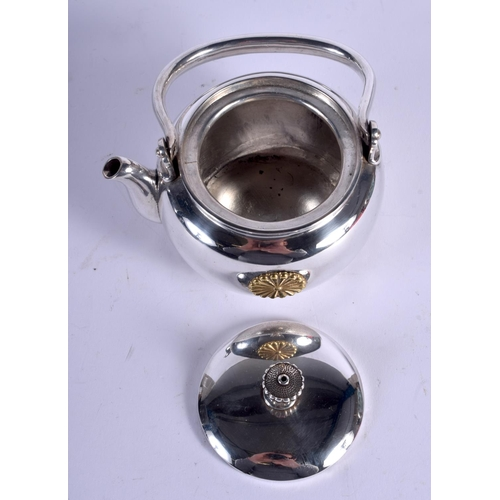 2116 - AN EARLY 20TH JAPANESE MEIJI PERIOD SILVER TEAPOT with imperial mon. 142 grams. 9 cm x 11 cm....
