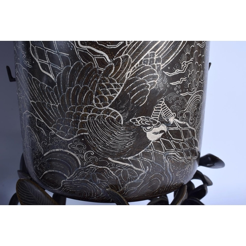 2126 - A LARGE PAIR OF 19TH CENTURY JAPANESE MEIJI PERIOD SILVER INLAID VASES ON STANDS decorated with hawk...
