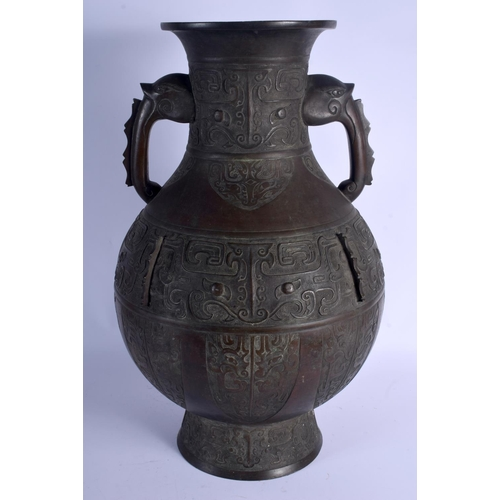 2136 - A VERY LARGE 18TH/19TH CENTURY CHINESE TWIN HANDLED BRONZE VASE Qing, decorated with mask heads and ...