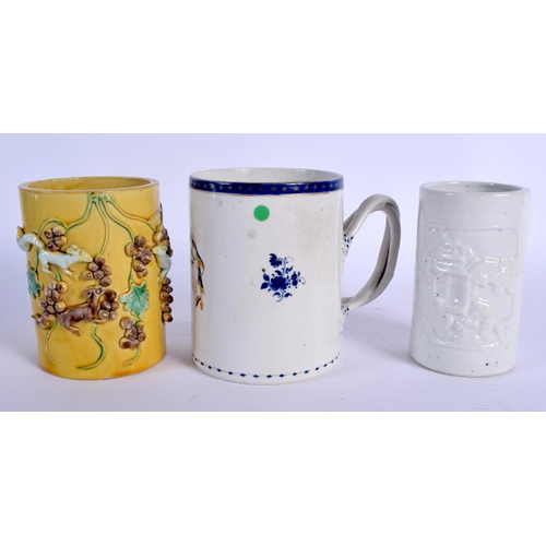 2143 - TWO 19TH CENTURY CHINESE PORCELAIN BRUSH POTS Qing, together with a Qianlong mug. (3)...