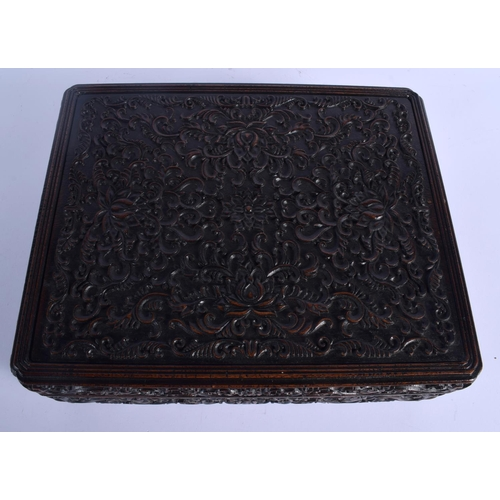 2147 - A LARGE EARLY 20TH CENTURY CHINESE CARVED WOOD DOCUMENT BOX AND COVER decorated with foliage. 34 cm ...