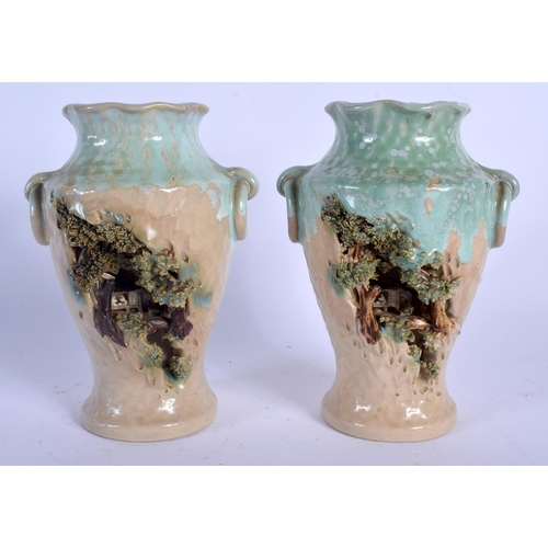 2150 - AN UNUSUAL PAIR OF EARLY 20TH CENTURY JAPANESE TAISHO PERIOD VASES decorated with figures within lan...
