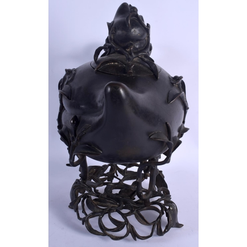 2156 - A VERY LARGE 18TH/19TH CENTURY CHINESE BRONZE PEACH FORM COVERED CENSER Qing, upon a naturalistic br...