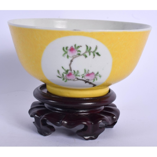 2165 - A CHINESE FAMILLE ROSE SCRAFITO PORCELAIN BOWL 20th Century, painted with peaches. 11 cm wide....