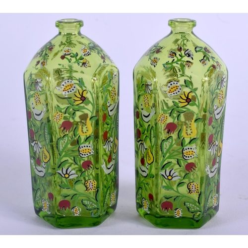 22 - A SMALL PAIR OF LATE 19TH CENTURY CONTINENTAL ENAMELLED GLASS BOTTLES painted with birds. 9 cm high....