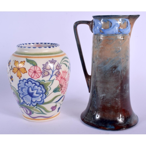 266 - A RARE ROYAL DOULTON SABRINA WARE JUG together with a Poole vase. Largest 19 cm high. (2)...
