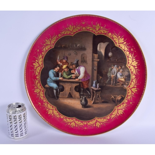 281 - A LARGE 19TH CENTURY VIENNA PORCELAIN CIRCULAR DISH painted with figures within an interior. 40 cm d...