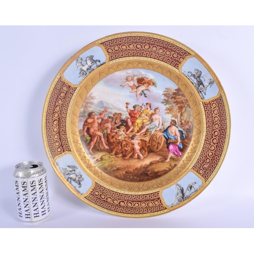 282 - A LARGE 19TH CENTURY VIENNA PORCELAIN CIRCULAR DISH painted with classical scenes within a landscape...