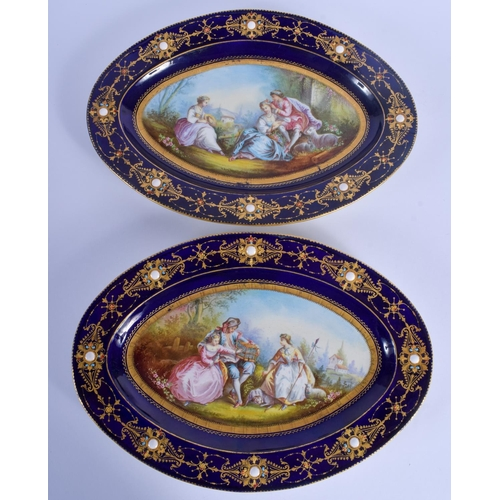 291 - A LARGE PAIR OF 19TH CENTURY FRENCH SEVRES PORCELAIN DISHES painted with lovers in a landscape. 30 c...