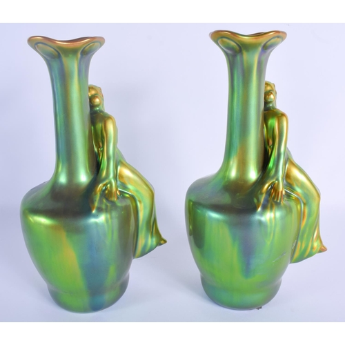 292 - A RARE PAIR OF HUNGARIAN ZSOLNAY PECS PORCELAIN VASES of iridescent form. 24 cm high....