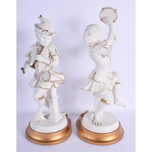 293 - A LARGE PAIR OF CONTINENTAL PORCELAIN FIGURES OF MONKEY MUSICIANS modelled upon gilt bases. 42 cm hi...
